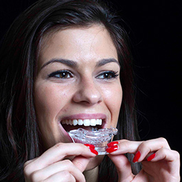 Teeth whitening Step 3: Put the tray filled with teeth whitening gel in your mouth.